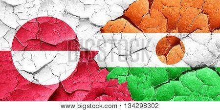 greenland flag with Niger flag on a grunge cracked wall