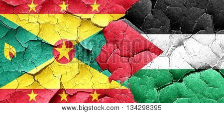 Grenada flag with Palestine flag on a grunge cracked wall