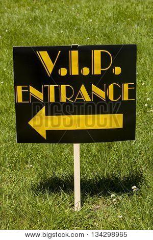 A directional V.I.P. entrance lawn sign decoration