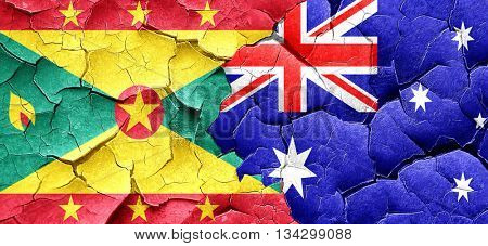 Grenada flag with Australia flag on a grunge cracked wall