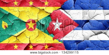 Grenada flag with cuba flag on a grunge cracked wall