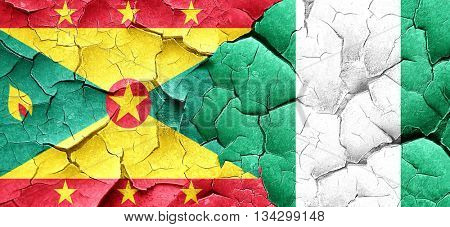 Grenada flag with Nigeria flag on a grunge cracked wall
