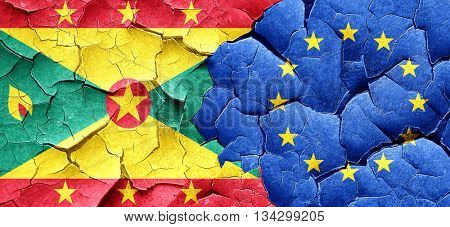 Grenada flag with european union flag on a grunge cracked wall