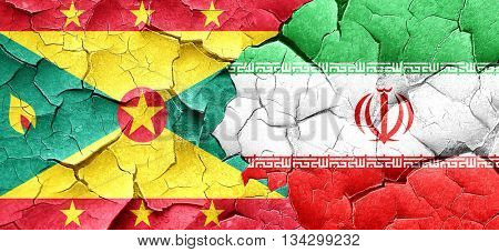 Grenada flag with Iran flag on a grunge cracked wall