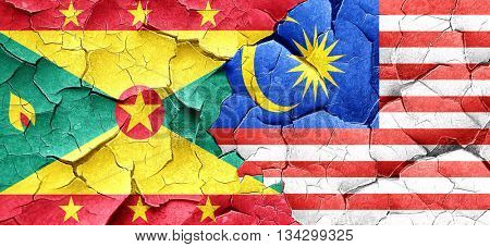 Grenada flag with Malaysia flag on a grunge cracked wall