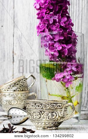 Still Life With Tea And Branch Of Lilac
