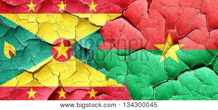 Grenada flag with Burkina Faso flag on a grunge cracked wall