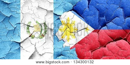 guatemala flag with Philippines flag on a grunge cracked wall