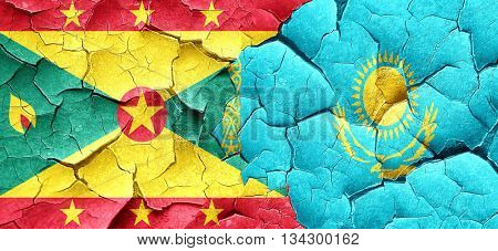 Grenada flag with Kazakhstan flag on a grunge cracked wall