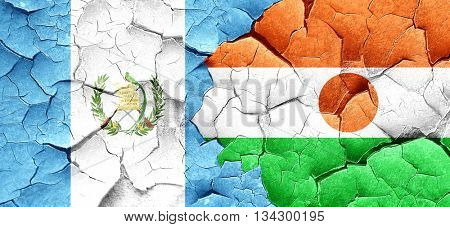 guatemala flag with Niger flag on a grunge cracked wall