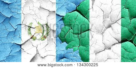guatemala flag with Nigeria flag on a grunge cracked wall