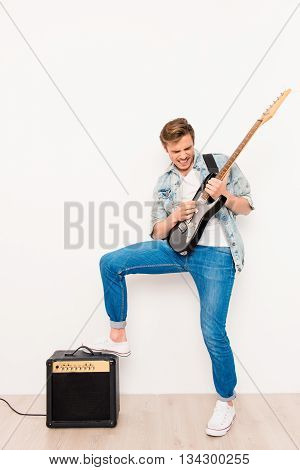Young Happy Cool Rocker Playing On Electric Guitar