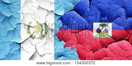 guatemala flag with Haiti flag on a grunge cracked wall