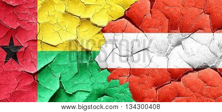 Guinea bissau flag with Austria flag on a grunge cracked wall