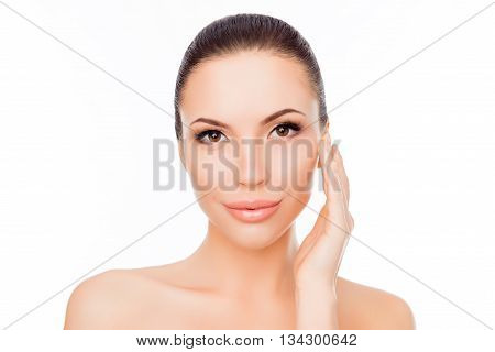Portrait Of Pretty Young Woman Touching Her Face