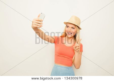 Cheerful Happy Woman Making Photo On Smartphone And Gesturing