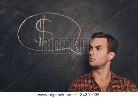 Serious Businessman With Crossed Hands Thinking How To Earn Money