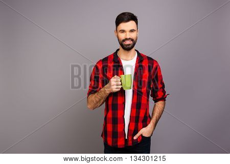 Happy Pretty Man Holding Cup Of Hot Tea