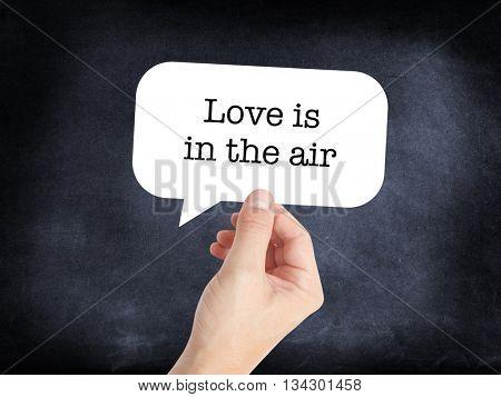 Love is in the air written on a speechbubble