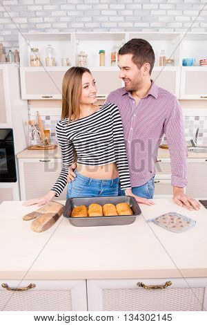 Pretty Smilling Couple In Love With Baked Pies In The Kitchen