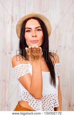 Pretty Woman In Summer Hat Sending Air Kiss