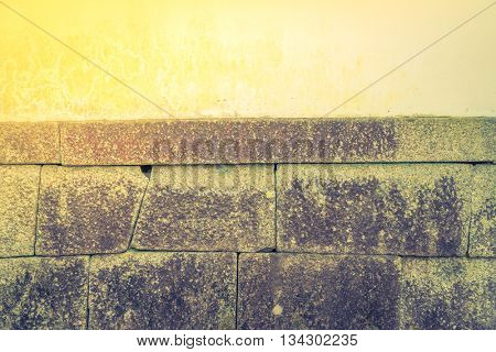 Stone wall texture background  ( Filtered image processed vintage effect. )