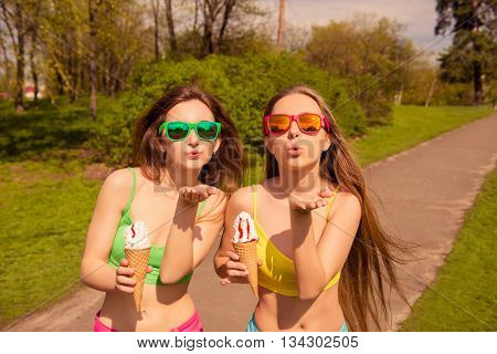 Two Beautiful Girl Walking In Park With Ice Cream And Sending Air Kiss