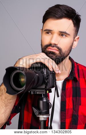 Portrait Of Sad Man With Camera Thinking About Photo Concept