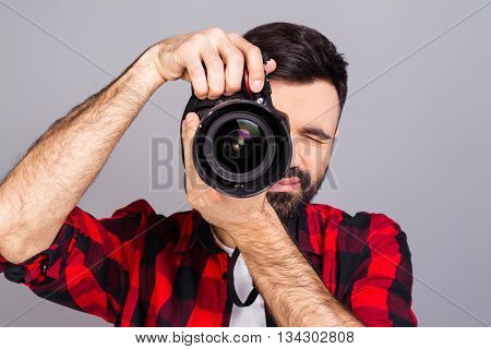 Young Man Taking Photo With Professional Digital Camera, Focus On Hand And Lens