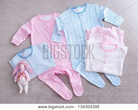 Baby clothes on fabric background