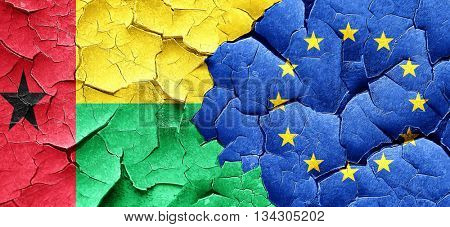 Guinea bissau flag with european union flag on a grunge cracked