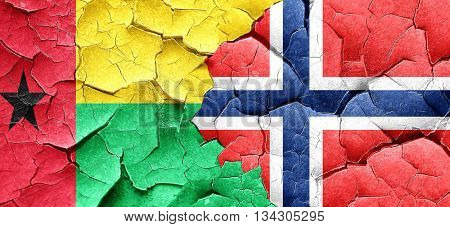 Guinea bissau flag with Norway flag on a grunge cracked wall