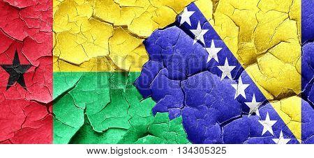 Guinea bissau flag with Bosnia and Herzegovina flag on a grunge
