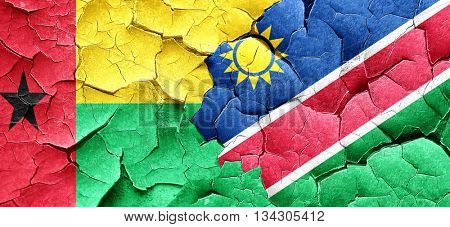 Guinea bissau flag with Namibia flag on a grunge cracked wall