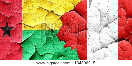 Guinea bissau flag with Peru flag on a grunge cracked wall