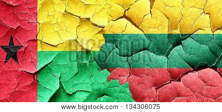 Guinea bissau flag with Lithuania flag on a grunge cracked wall