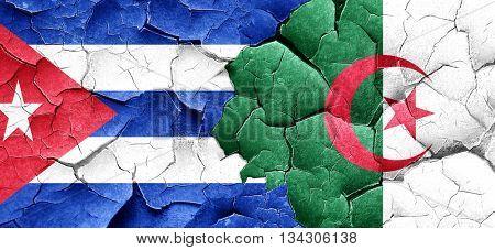 Cuba flag with Algeria flag on a grunge cracked wall