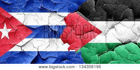 Cuba flag with Palestine flag on a grunge cracked wall