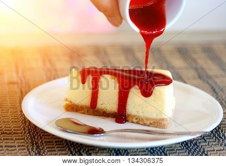 Pour Strawberry Sauce Into Cheesecake