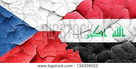 czechoslovakia flag with Iraq flag on a grunge cracked wall