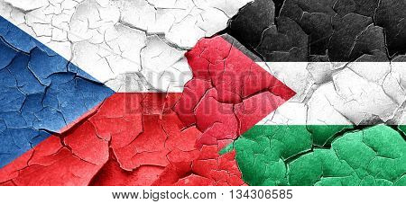czechoslovakia flag with Palestine flag on a grunge cracked wall