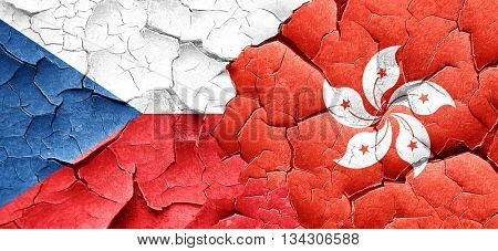 czechoslovakia flag with Hong Kong flag on a grunge cracked wall