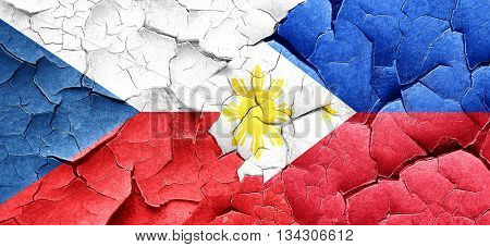 czechoslovakia flag with Philippines flag on a grunge cracked wa