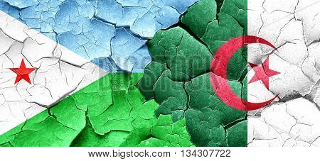 Djibouti flag with Algeria flag on a grunge cracked wall