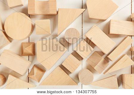 Wooden children's cubes on white wooden background