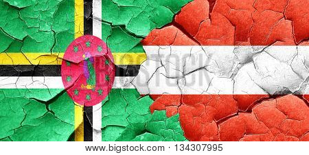 Dominica flag with Austria flag on a grunge cracked wall