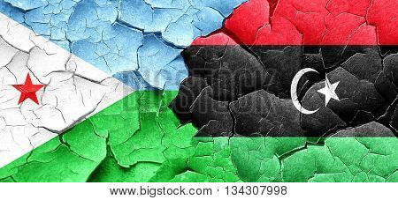 Djibouti flag with Libya flag on a grunge cracked wall