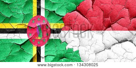 Dominica flag with Indonesia flag on a grunge cracked wall