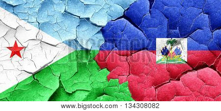 Djibouti flag with Haiti flag on a grunge cracked wall