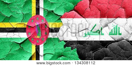 Dominica flag with Iraq flag on a grunge cracked wall